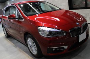 BMW 218d アクティブツアラー フラメンコレッドブリリアントエフェクト フロントバンパー右